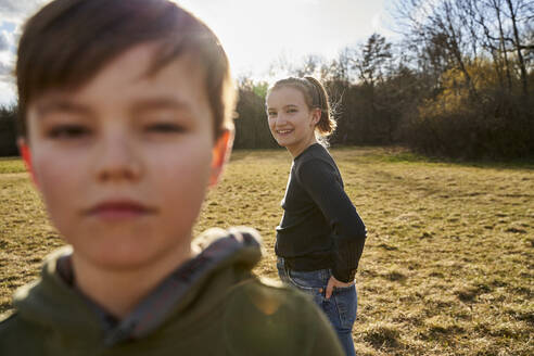 Brother and sister on a meadow - AUF00277