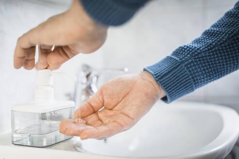 Man washing his hands with liquid soap, close-up - MCVF00264
