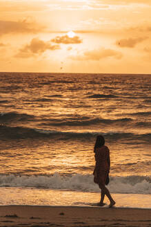 Woman at the seafront at sunrise, Miami, Florida, USA - DAWF01285