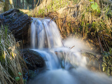 Germany, Bavaria, Long exposure of splashing stream in Upper Palatinate Forest - HUSF00123