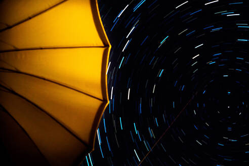 Low Angle View Of Yellow Umbrella Against Star Field At Night - EYF03466