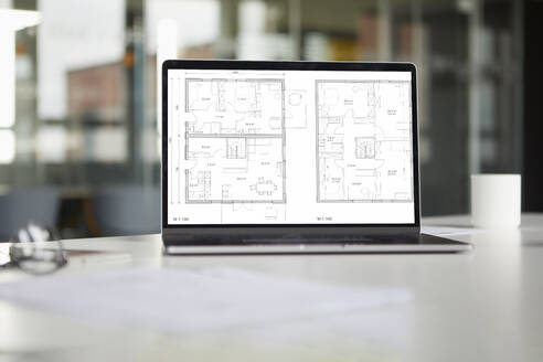 Tablet with floor plan in office - RBF07432