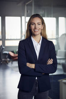 Portrait of smiling businesswoman in office - RBF07510