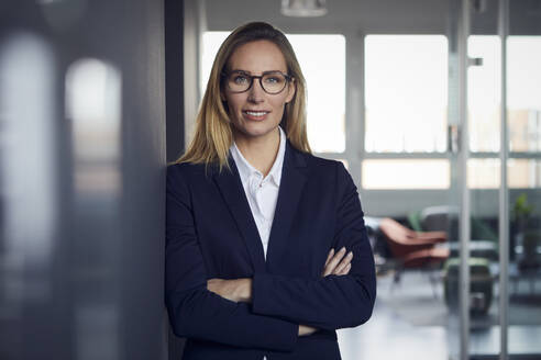 Portrait of confident businesswoman in office - RBF07516