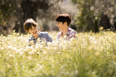 Happy mother and daughter in a field of wildflowers - VSMF00094