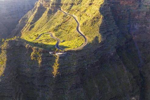 Spain, Santa Cruz de Tenerife, Valle Gran Rey, Aerial view of winding road at Mirador Cesar Manrique - SIEF09753