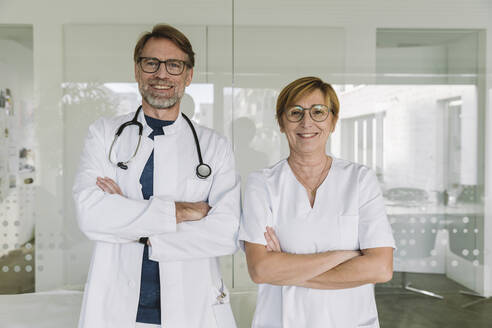 Portrait of confident doctor and assistant in medical practice - MFF05455
