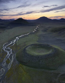 River and crater in evening in highlands - CAVF79039
