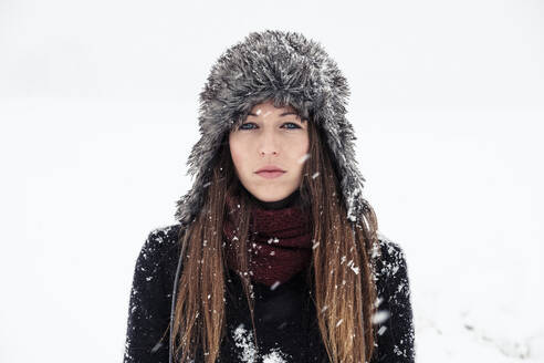 Portrait of serious young woman in winter - WFF00297