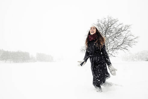Happy young woman dancing in winter landscape - WFF00306