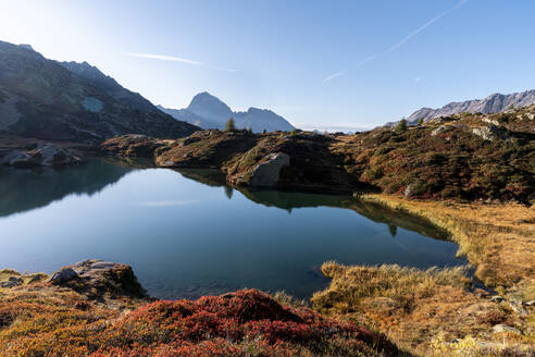 Switzerland, Canton of Grisons, Shore of Crap Alv Lajets lake at autumn sunset - HBIF00096
