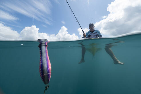 Split shot of man in a kayak fishing with a lure - AMUF00047