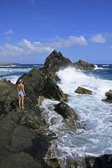 Woman standing at natural pool, Arikok National Park, Aruba, Antilles - ECPF00883