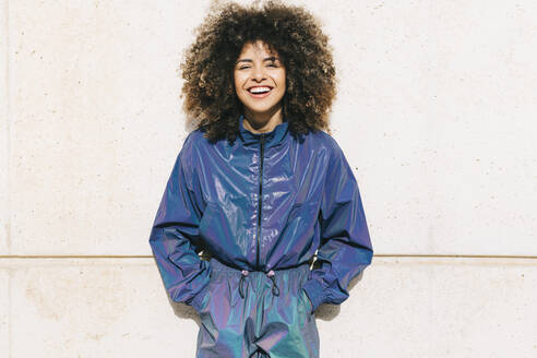 Portrait of happy stylish young woman wearing tracksuit outdoors - AGGF00028