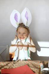 Portrait of little girl with self-made bunny ears - KMKF01287