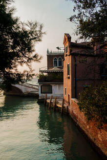 Italy, Venice, Waterfront houses at dusk - FMOF00959