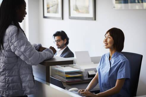 Patient at reception desk of a dental practice - PWF00001