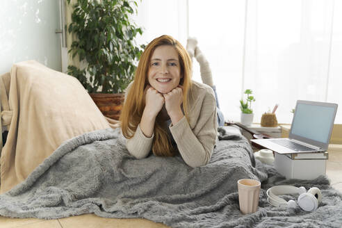 Portrait of happy young woman at home - AFVF05998