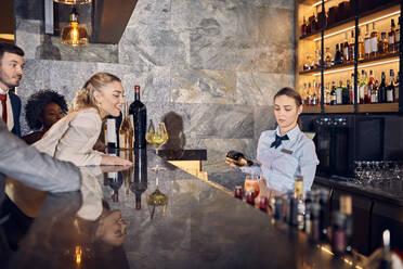 Barwoman preparing drinks in a bar - ZEDF03258