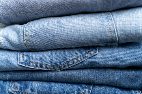 Stack of blue jeans, close-up - FMOF00968
