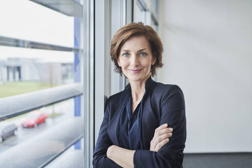 Portrait of confident businesswoman at the window - RORF02120