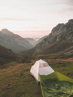 Spain, Cantabria, White tent pitched in Picos de Europa at dawn - FVSF00148