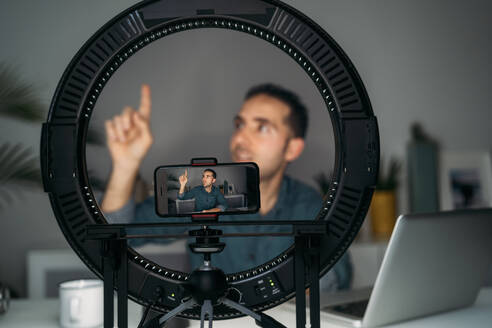 Vlogger filming with smartpone at home - MPPF00849