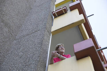 Senior woman on balcony, retirement home - JATF01191