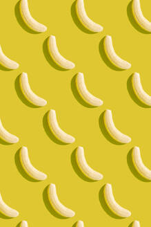 3D illustration of peeled bananas on yellow background - GEMF03597