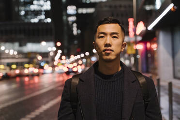 Portrait of a man in the city at night - AHSF02303