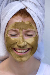 Portrait of laughing teenage girl with facial mask - LBF03046