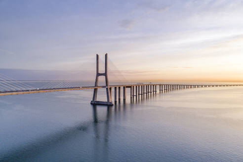 Portugal, Lisbon, Vasco da Gama Bridge at moody sunrise - RPSF00285