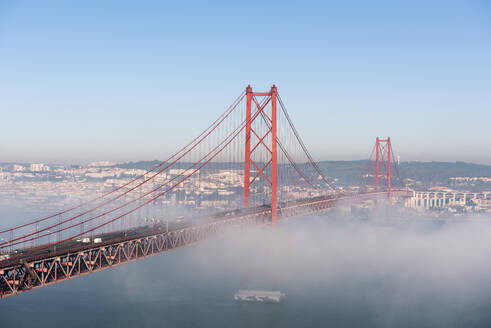 Portugal, Lisbon, 25 de Abril Bridge during foggy weather - RPSF00291