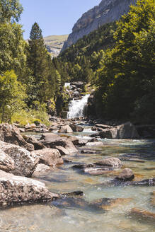 Spain, Province of Huesca, Small waterfall on clear mountain river - FVSF00216