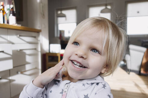 Portrait of happy toddler girl at home - JOSEF00325