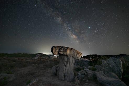 Milky way panorama above a mushroom-shaped rock - CAVF80167