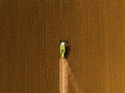 Aerial view of combine harvester on a field of soybean - NOF00081