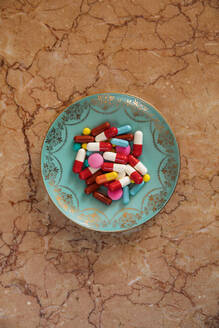 Plate with bunch of various pills and capsules - JMF00498