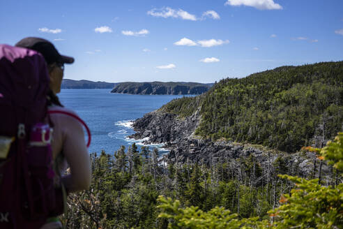 Young Backpacker Looks Back On East Coast Trail In Newfoundland - CAVF80629