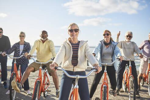 Portrait smiling, confident active senior friend tourists bike riding - CAIF26480