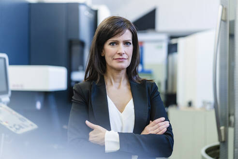 Portrait of a confident businesswoman in a factory - DIGF10109