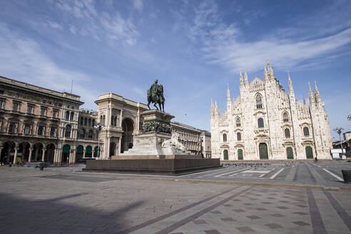 Italy, Milan, Monument to Victor Emmanuel II standing at empty Piazza del Duomo during COVID-19 outbreak - MEUF00571