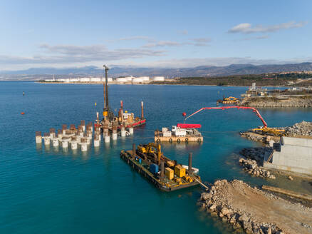 Aerial view of machinery at the construction of future LNG terminal on the shore of the bay in Omisalj, Croatia - AAEF08035