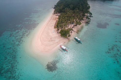 Aerial view of one of the famous tourist spots in the town of Port Barton is the Inaladelan Island resort. An island part of Port Barton in the municipality of San Vicente, Palawan, Philippines. - AAEF08273