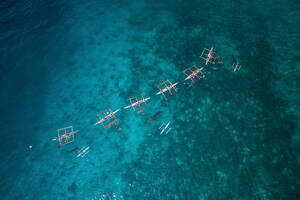 Aerial view of tourists enjoying the whale shark watching in Barangay Tan-Awan town of Oslob, Province of Cebu, Philippines - AAEF08279