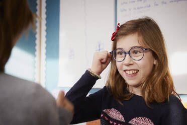 Portrait of smiling girl in a class during a lesson - PWF00061