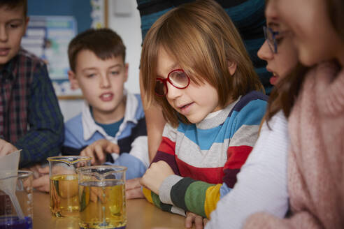 Group of children in a science chemistry lesson - PWF00064
