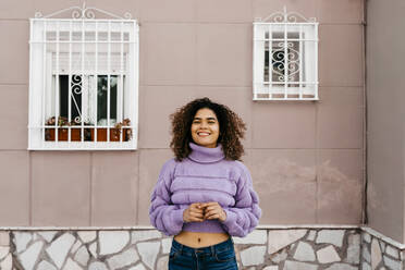 Portrait of smiling woman with windows in the background - TCEF00547