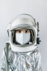 Boy wearing space suit and protective mask - JCMF00677