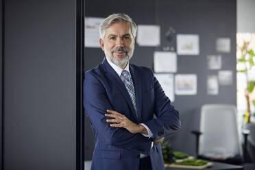 Portrait of confident mature businessman in office - RBF07671